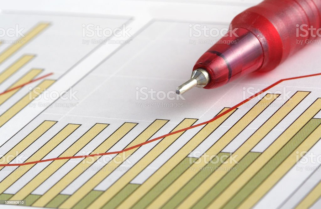 Pen on Positive Earning Chart royalty-free stock photo