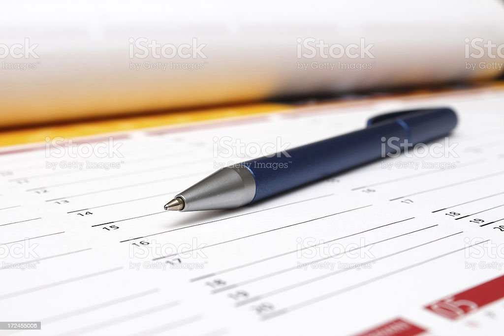 pen on table calendar royalty-free stock photo