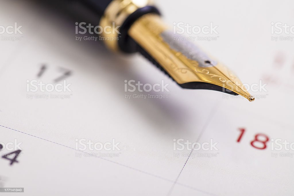 Pen on the calendar royalty-free stock photo