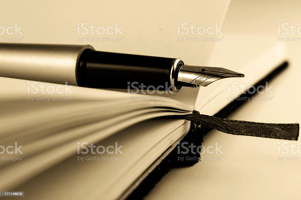 Pen on the notebook stock photo