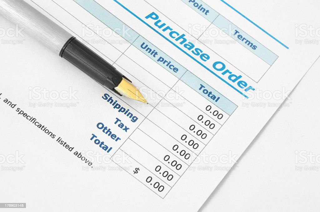 A pen on top of a purchase order paper stock photo