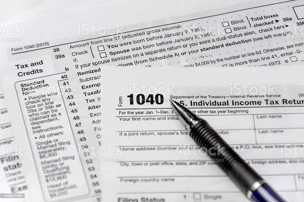 Pen on US tax form 1040 stock photo