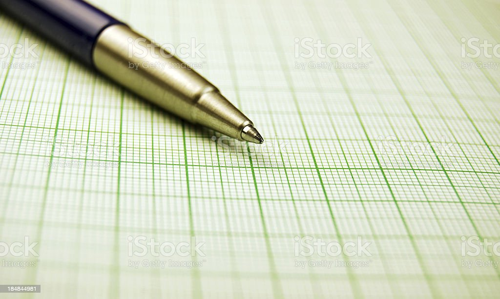 Pen over a graph paper stock photo