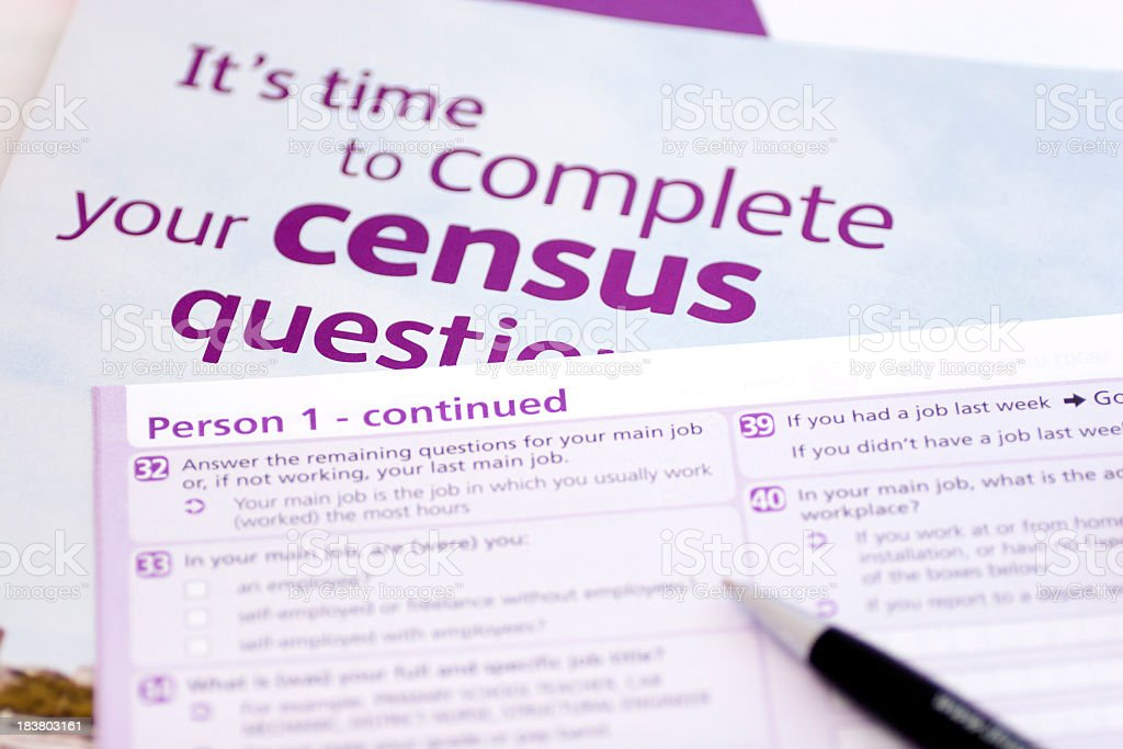 Pen over purple and white census forms royalty-free stock photo
