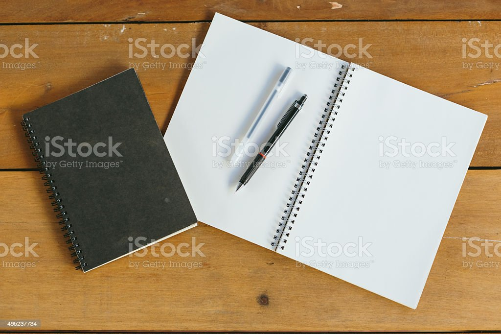 pen, pencil and notepad. flat lay style stock photo