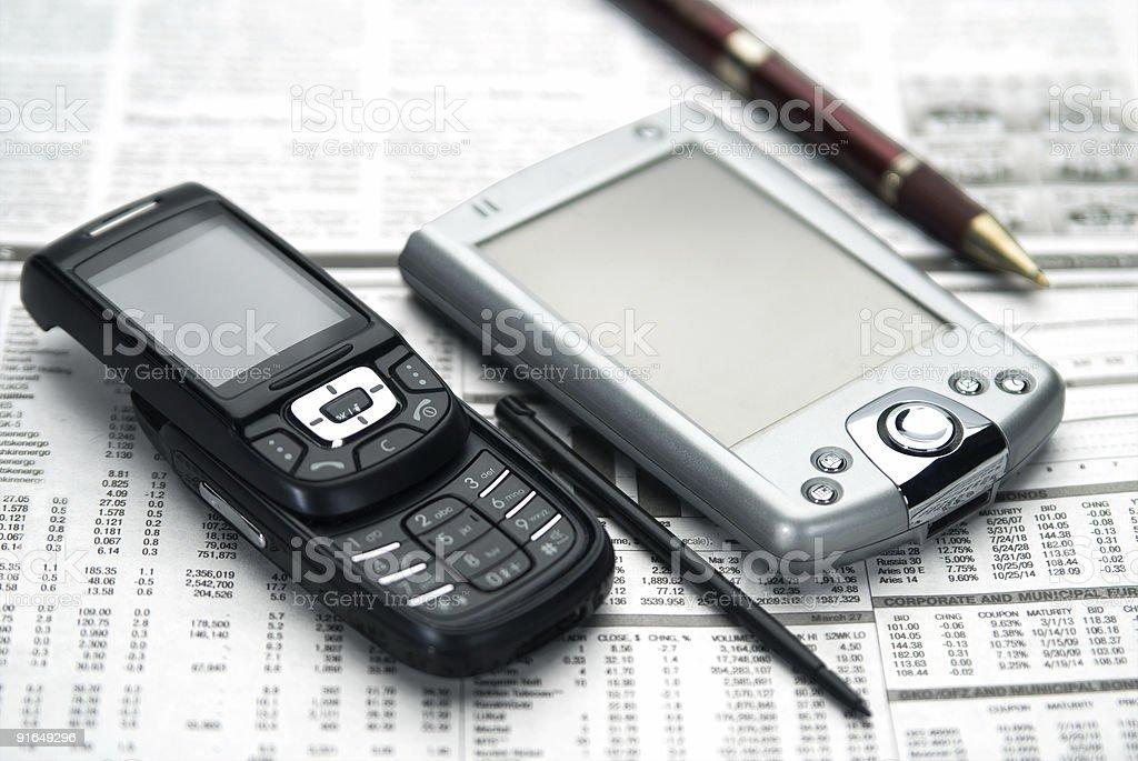 Pen, pocket, mobile on newspaper. royalty-free stock photo