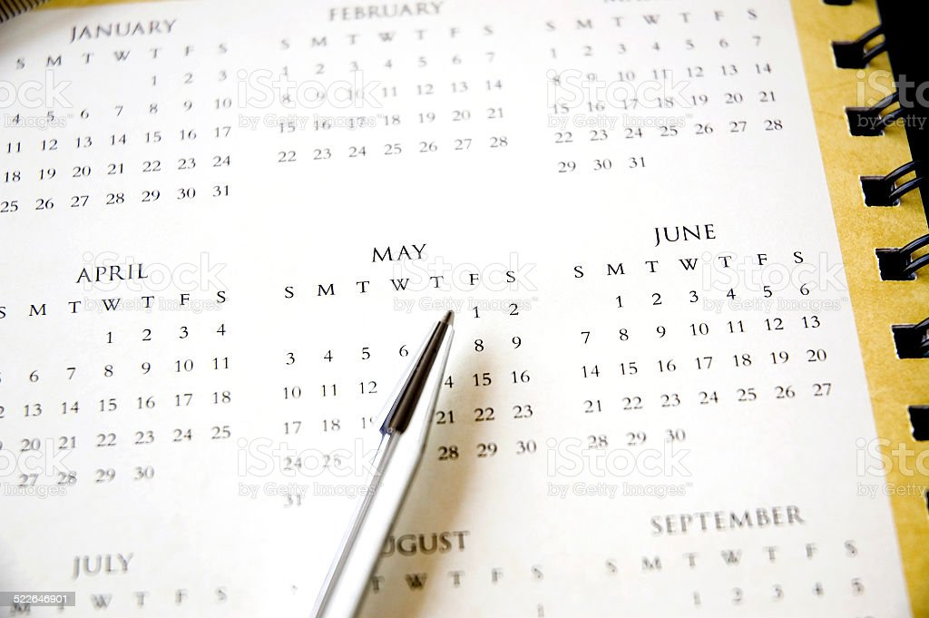 pen point to public holiday stock photo