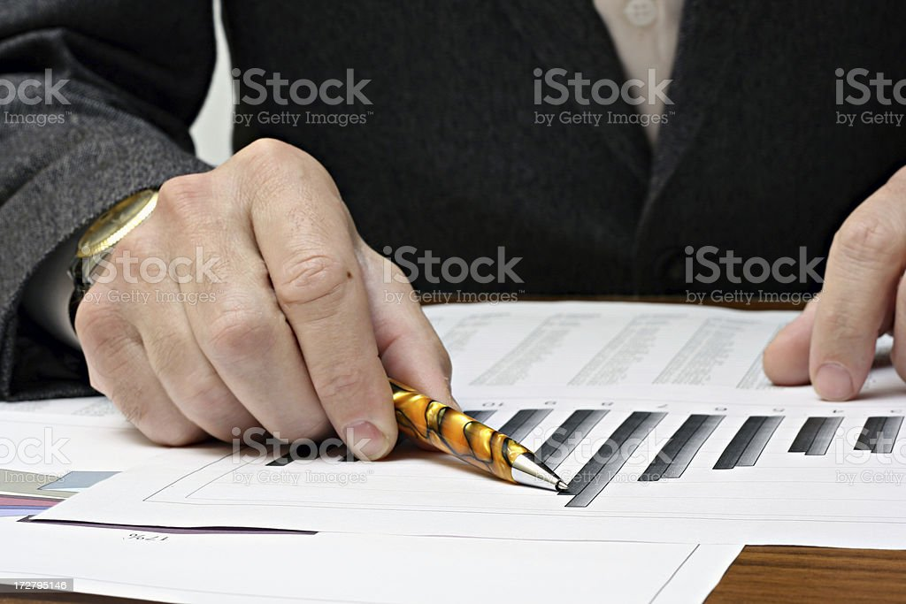 A pen pointing to financial results royalty-free stock photo