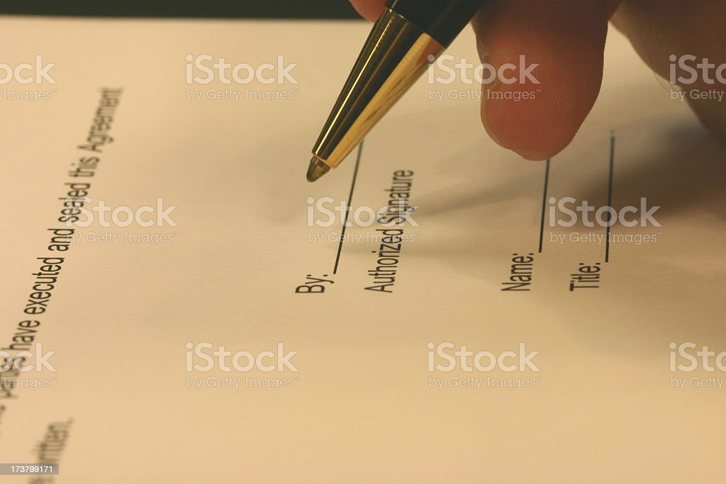 Pen posed to sign an authorized signature royalty-free stock photo