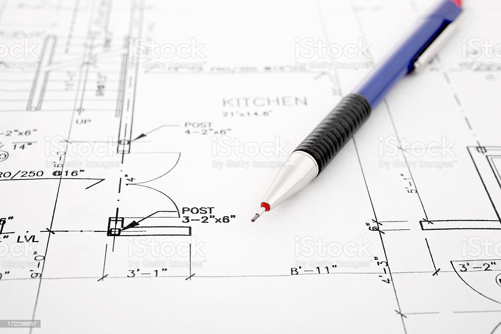 Pen resting on blueprints royalty-free stock photo
