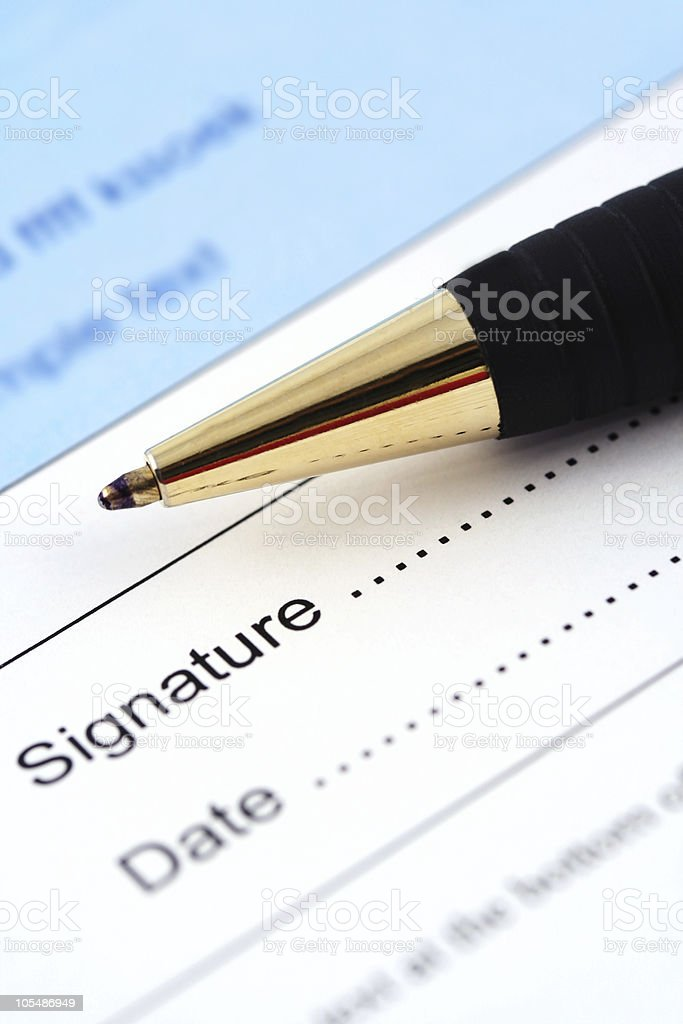 Pen Resting on Signature and Date Page royalty-free stock photo