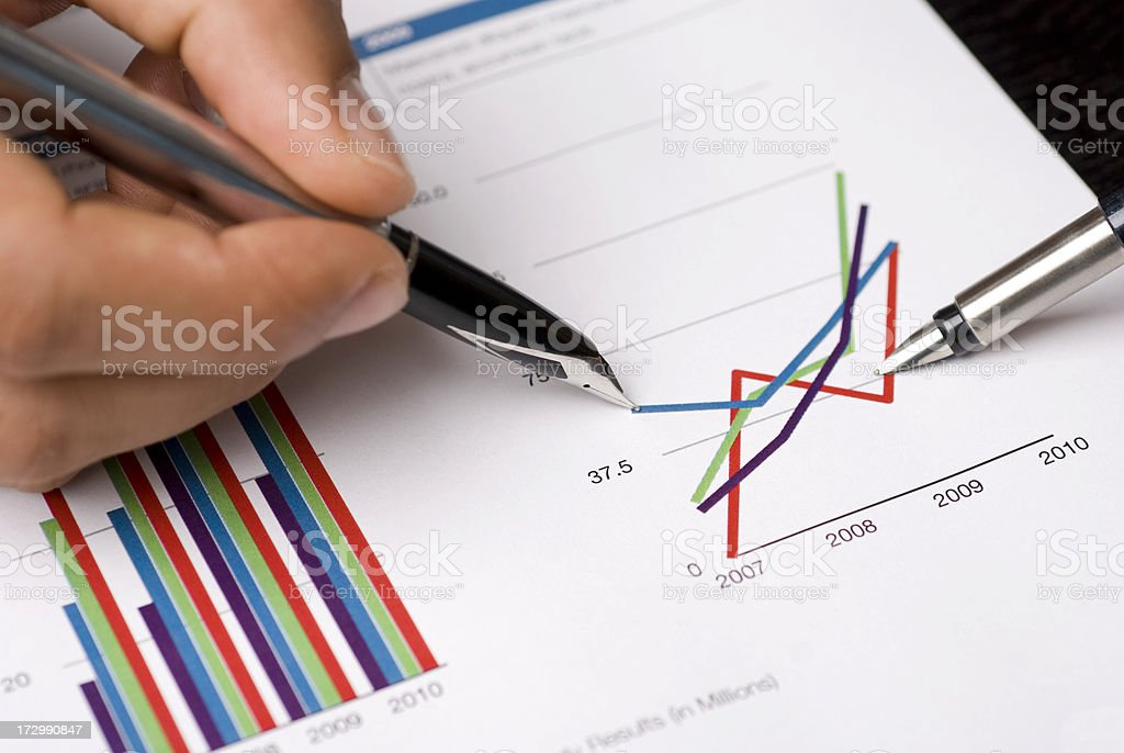 pen showing diagram on financial report royalty-free stock photo