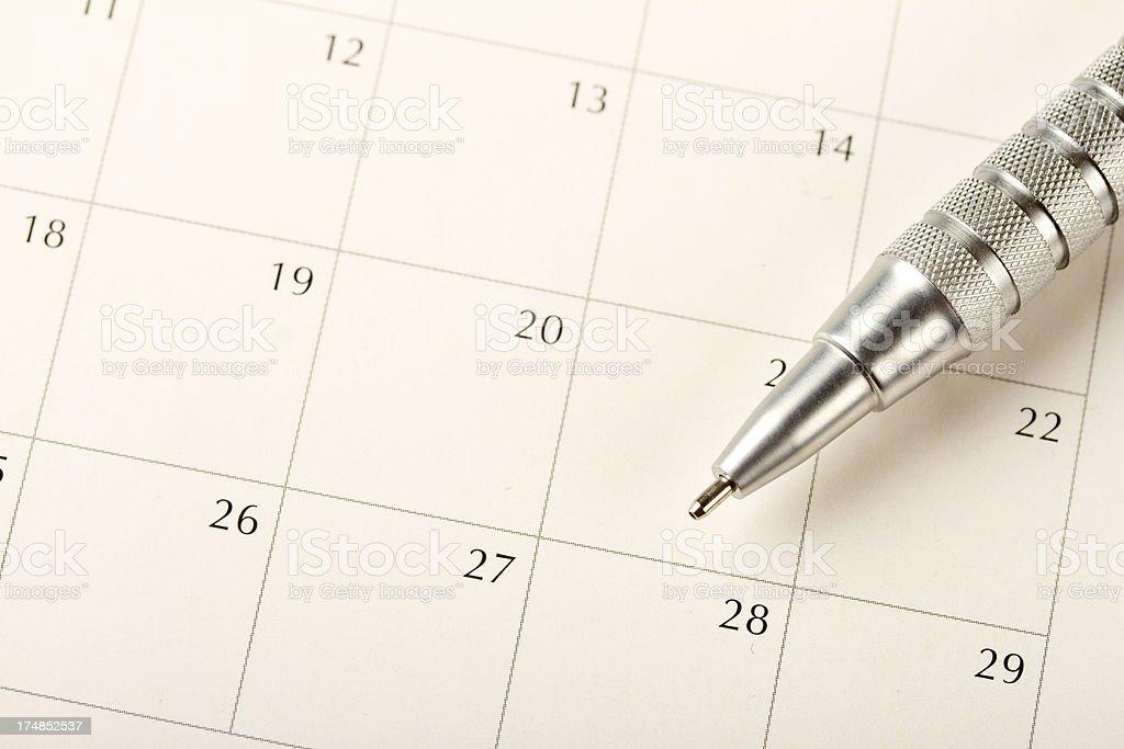 Pen sitting on a blank calendar royalty-free stock photo