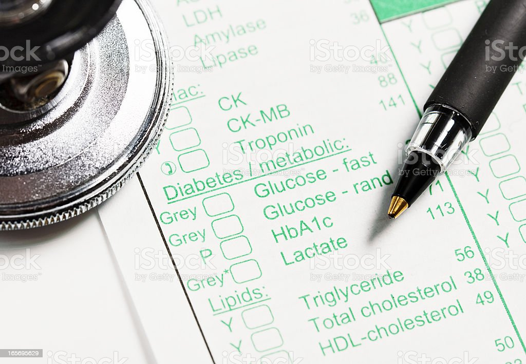 Pen, stethoscope on medical record concerning Diabetes and metabolism stock photo