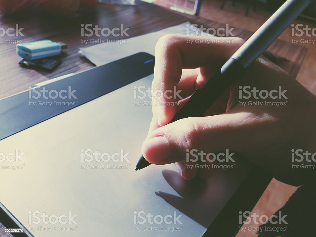 pen tablet with sun light drawing stock photo