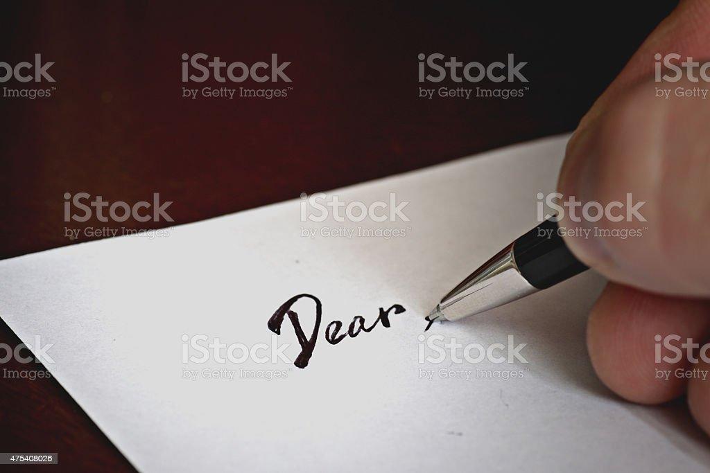 pen to write a letter dear stock photo