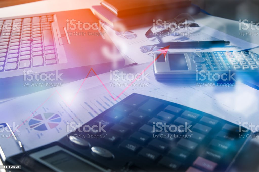 Pen with business graphs and charts report , calculator on desk of financial planing. Financial abstract concepts. stock photo