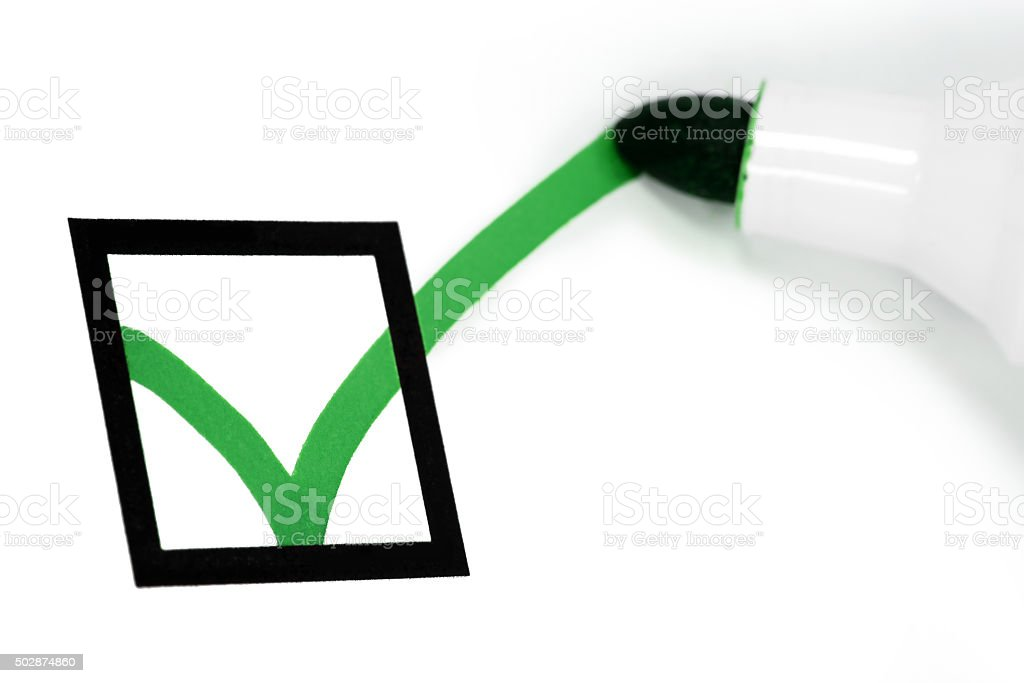 Pen writing green check mark stock photo