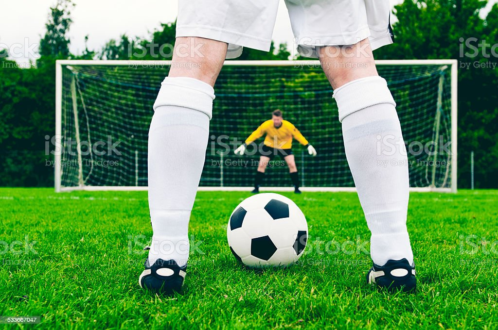 Penalty kick in a football game stock photo