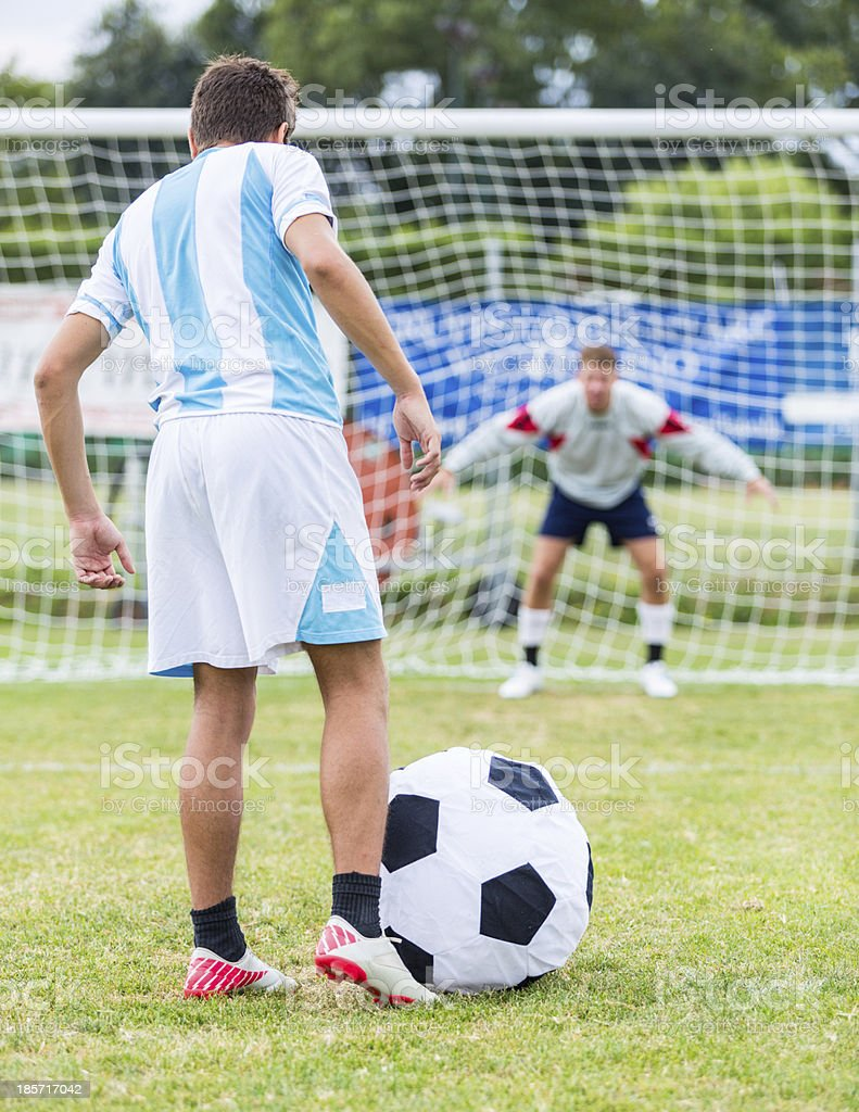 Penalty Kick with Big Funny Ball stock photo