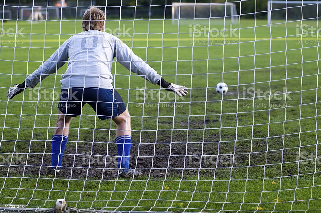 Penalty shoot out and goalkeeper is ready in the goal stock photo