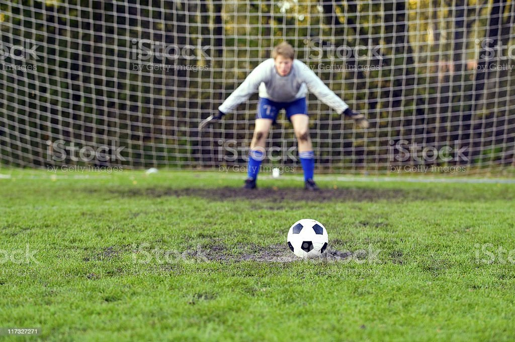 Penalty shoot out with the goalkeeper ready stock photo