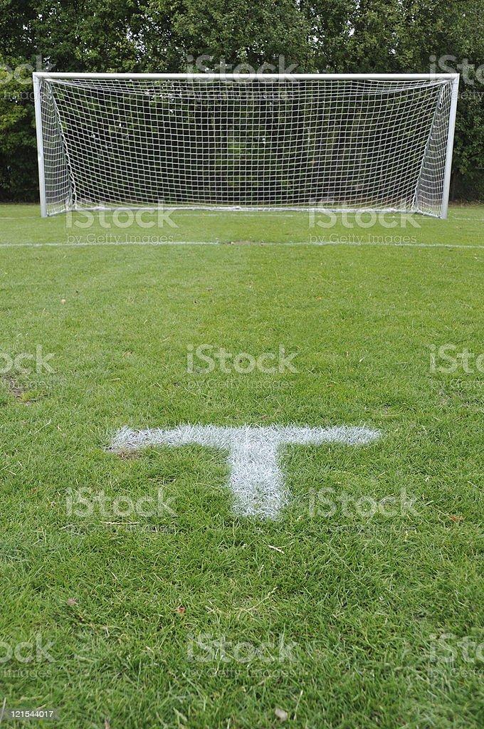 Penalty spot on green soccer field royalty-free stock photo