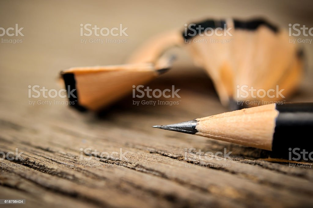 Pencil after shavings on wooden table stock photo