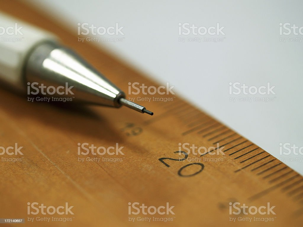pencil and brown wooden ruler stock photo