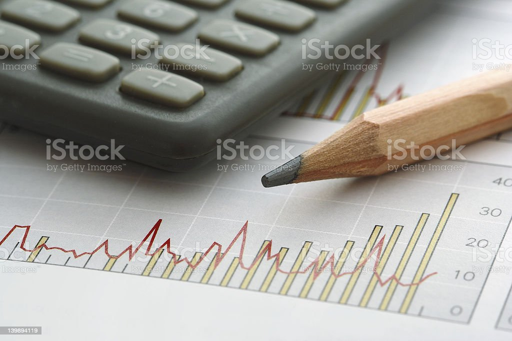 Pencil and Calculator on Chart royalty-free stock photo