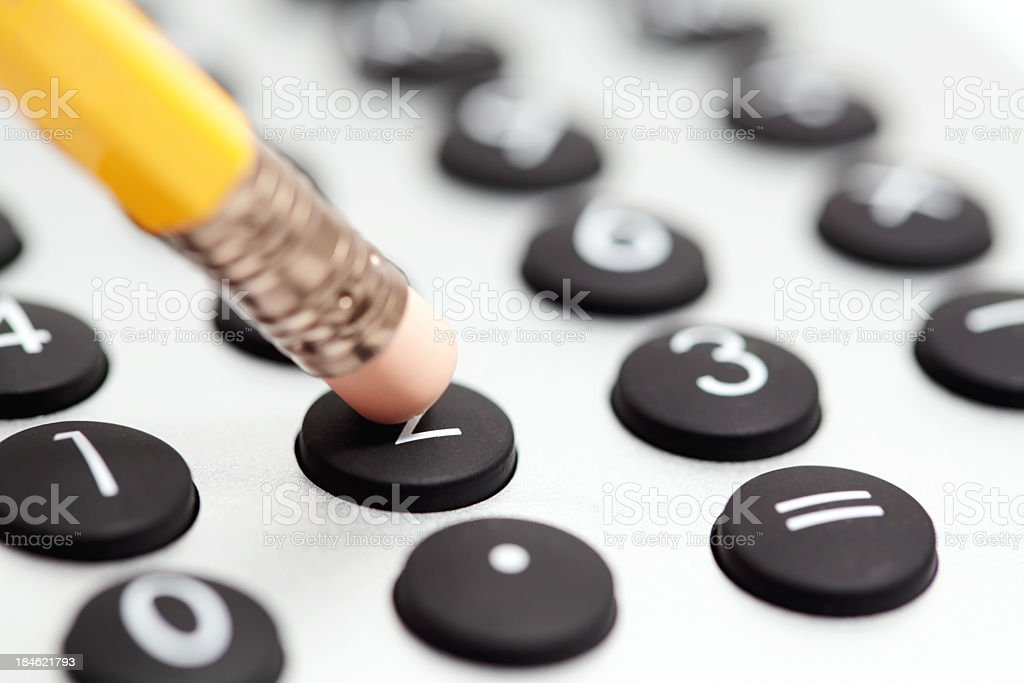 Pencil and calculator stock photo
