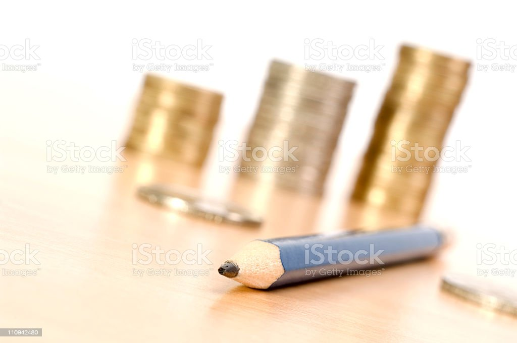 Pencil and coins money royalty-free stock photo