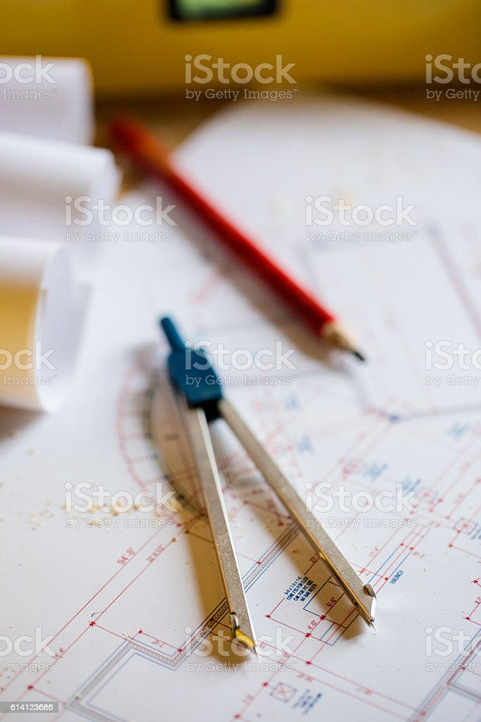 Pencil and devider on floor plans stock photo