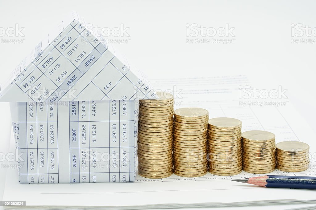 Pencil and house with many pile of gold coins royalty-free stock photo