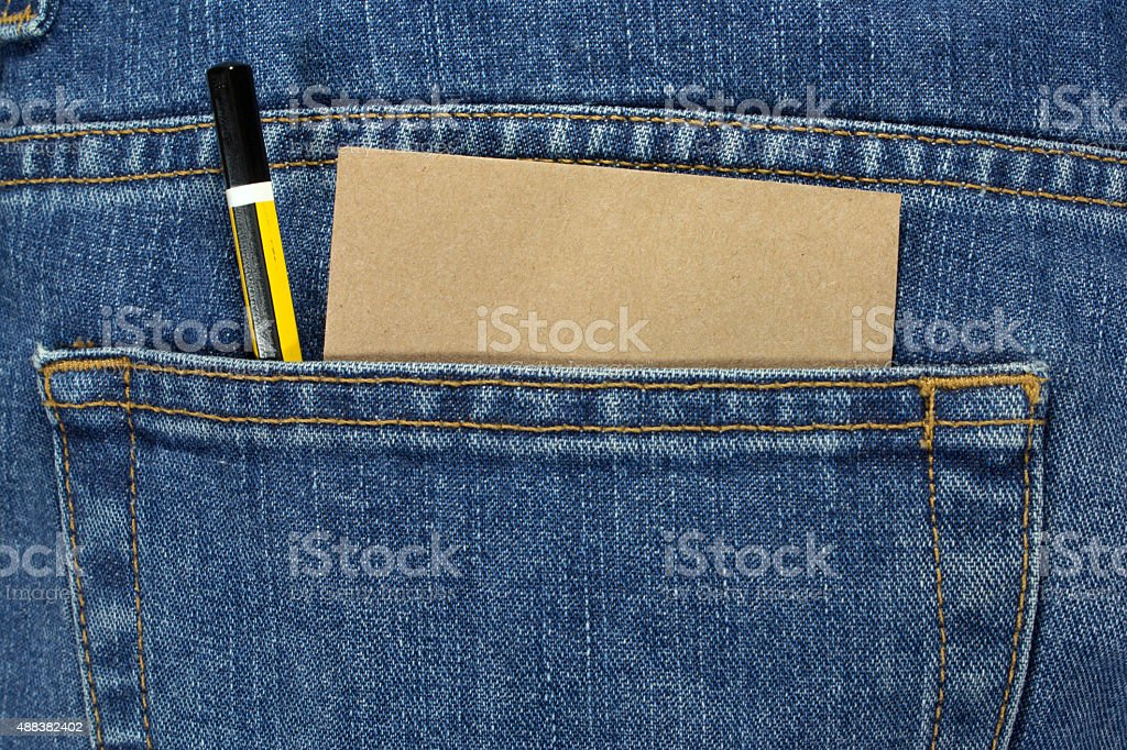 pencil and note paper in a blue jean pocket stock photo