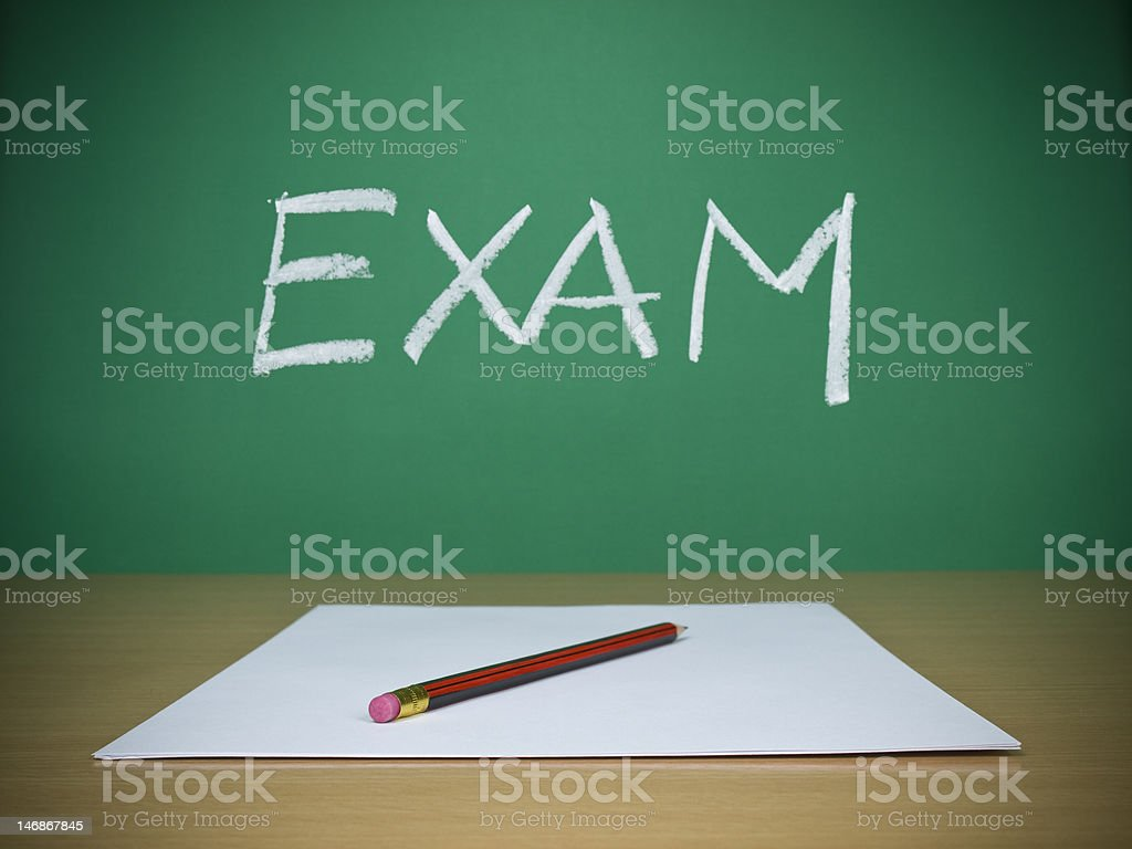 Pencil and paper with exam printed on chalkboard royalty-free stock photo
