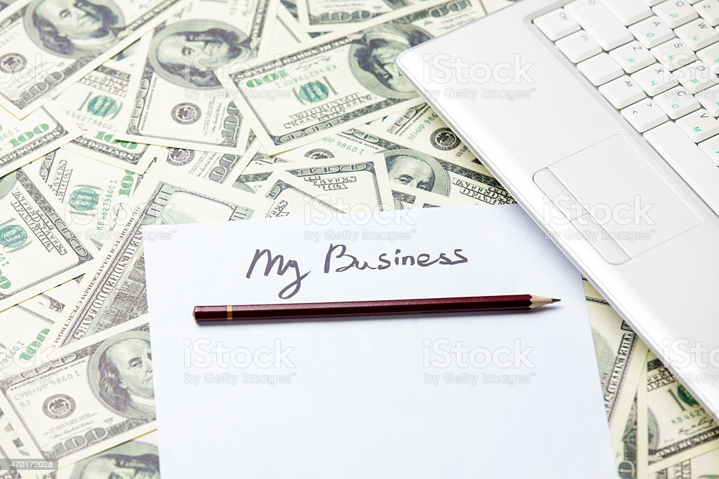 pencil and paper with My Business words near notebook stock photo