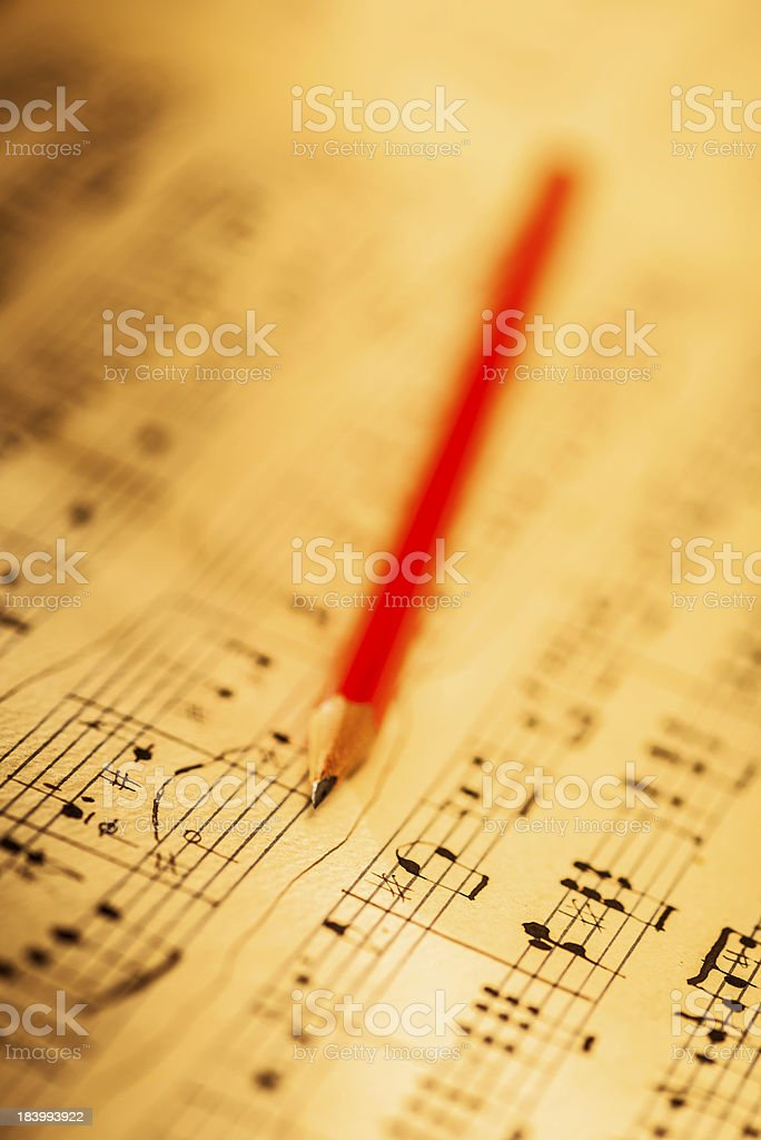 Pencil and sheet music stock photo