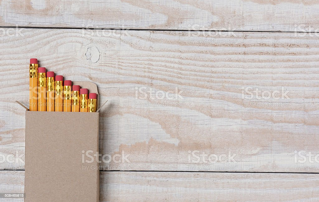Pencil Box on White Wood Desk stock photo
