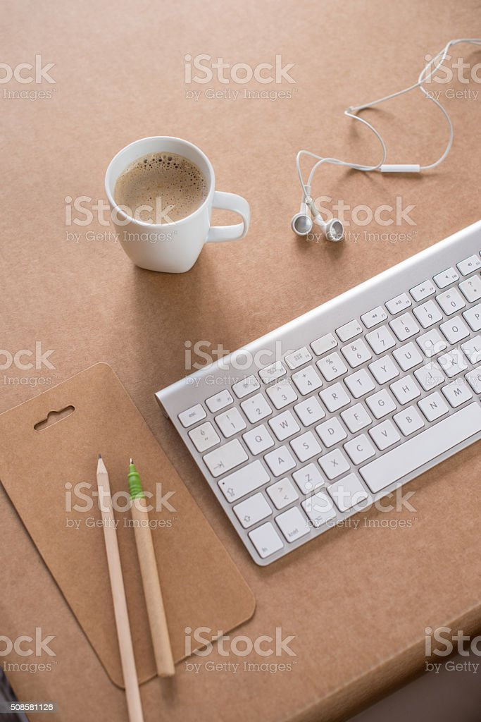 Pencil, coffee, keyboard and headphone on desk stock photo