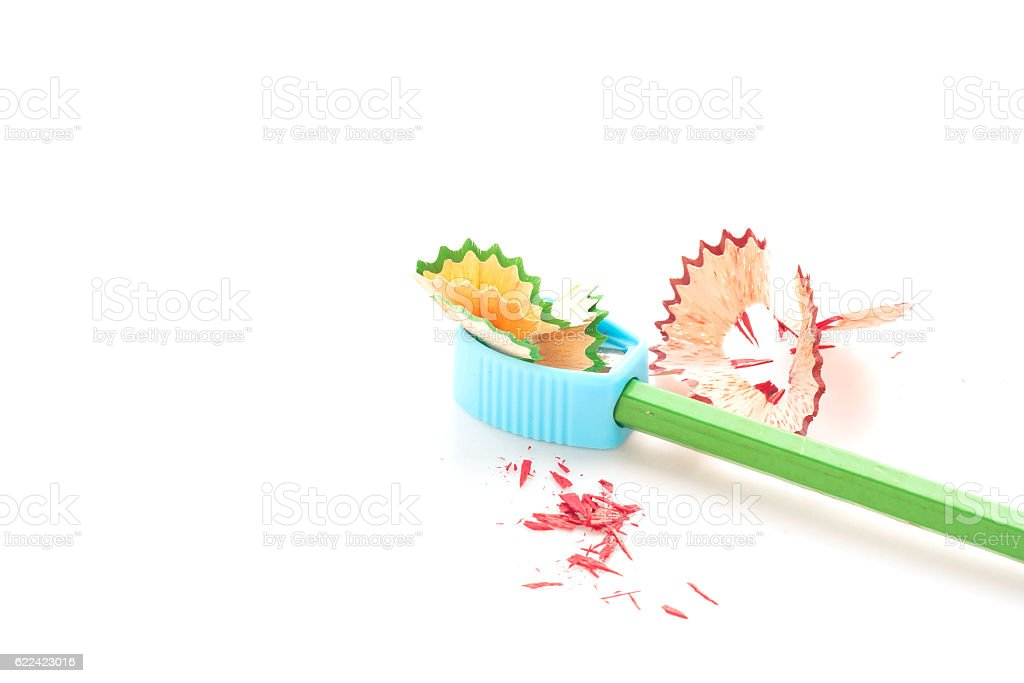 Pencil crayon and sharpener on white background. stock photo