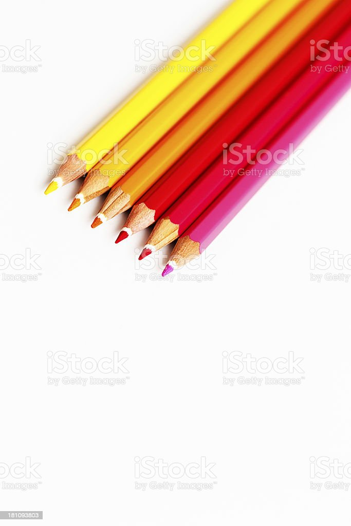 Pencil crayons shaded from red to yellow in diagonal line royalty-free stock photo