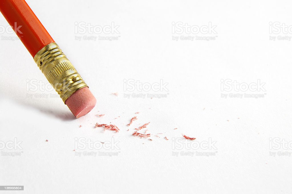 A pencil dataset leaving a trail of eraser shavings stock photo