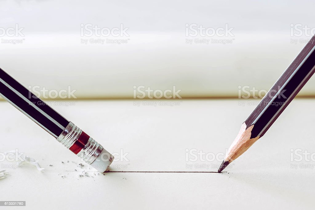 pencil draws a straight line on paper and pencil eraser stock photo
