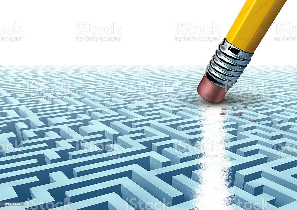 Pencil eraser erasing a blue maze stock photo