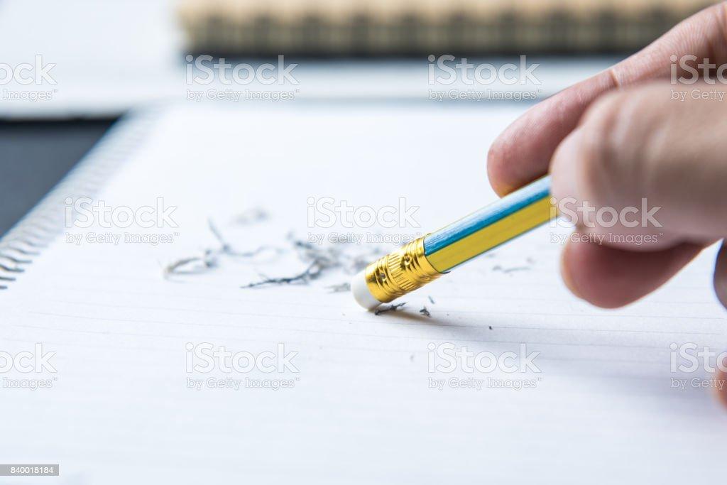 pencil eraser with eraser dust on notebook
