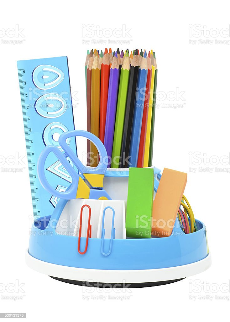 Pencil holder with a rule, scissors, erasors and many-colored pencils stock photo