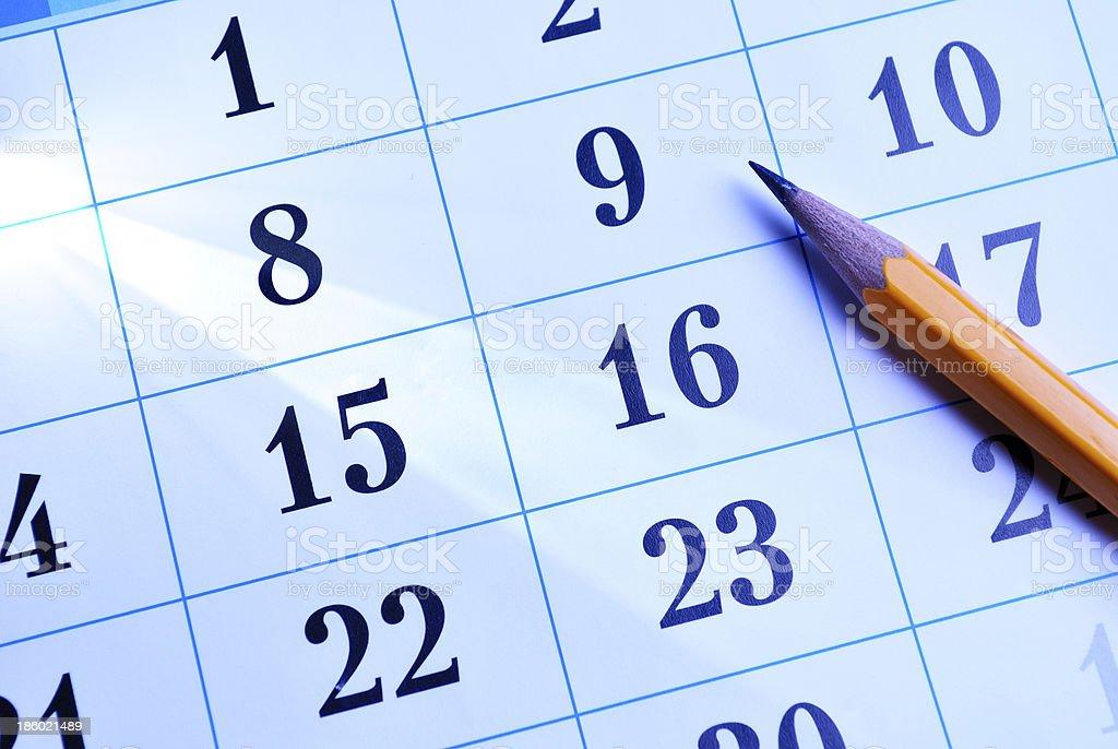 Pencil on a calendar stock photo