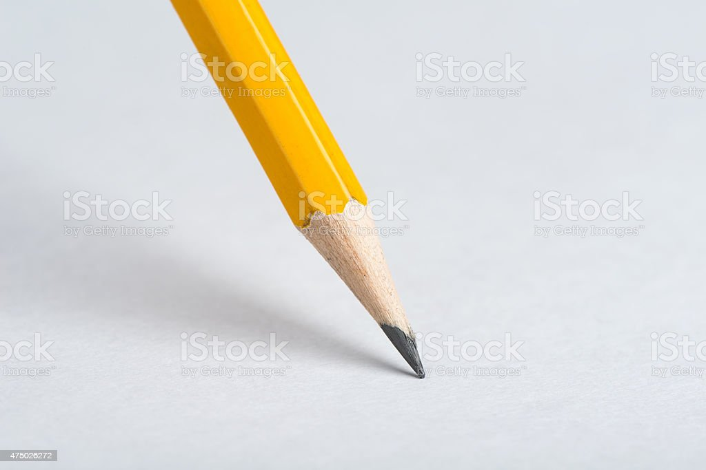 Pencil on a white paper background. stock photo