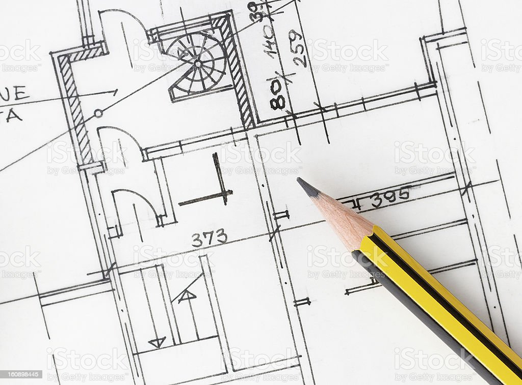Pencil on architectural plans royalty-free stock photo